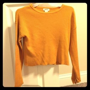 A Forever 21 mustard yellow long sleeved shirt.